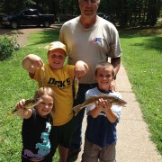 Cottage kids holding fish