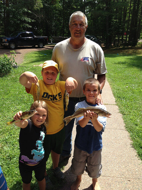 Kids and Grandpa holding fish