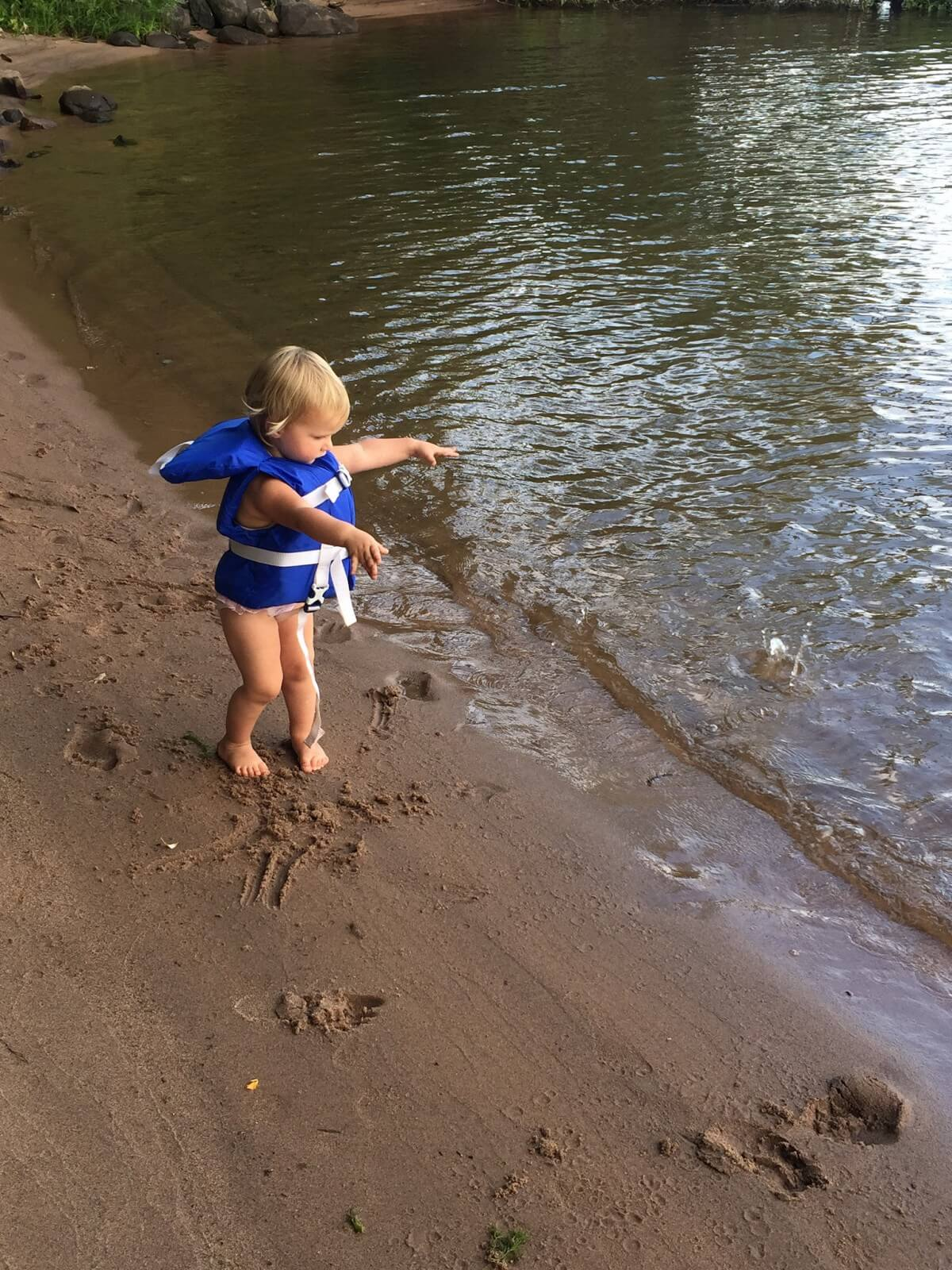 baby playing on beach