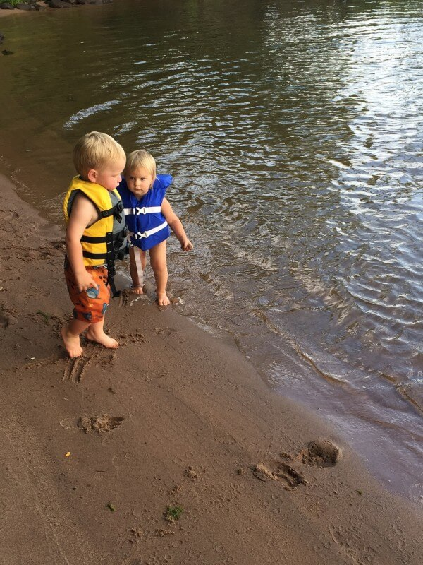 kids at the beach at Mission Springs Resort Ashland Wisconsin