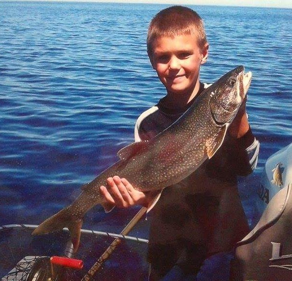 big fish caught by child on lake superior