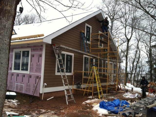 new siding on Lake House