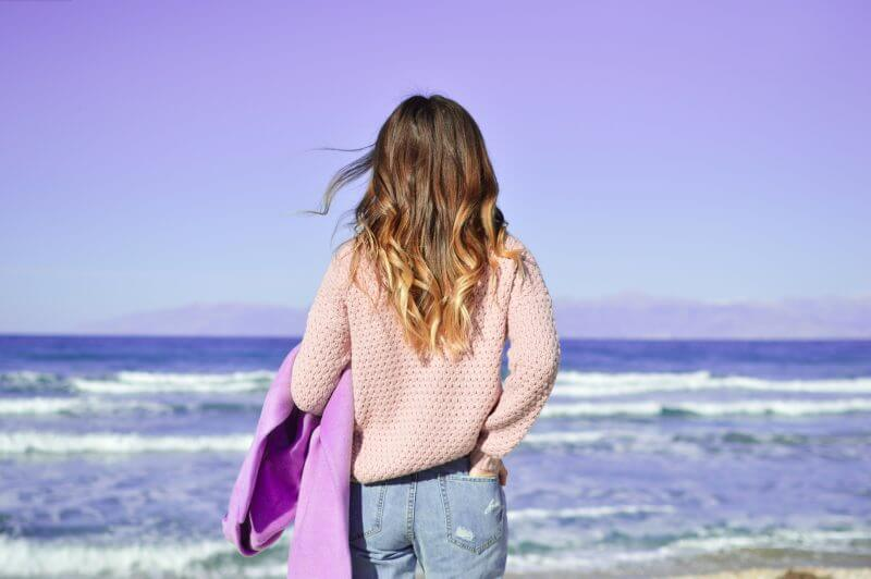 Woman in Sweater at the Beach