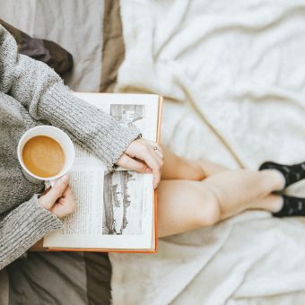 Girl Holding Book and Drinking Coffee