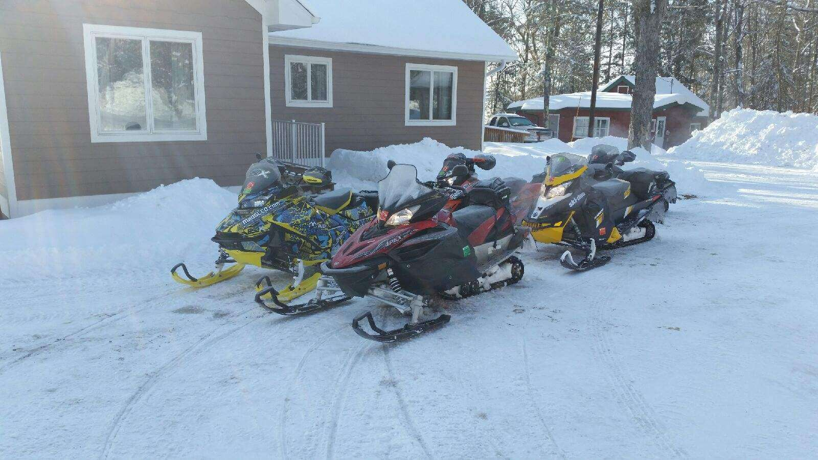 Snowmobiles in front of Lake House
